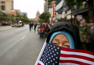 Sandra Ellis remembers her brother who died in the Vietnam War during the Veterans Day parade on Congress Avenue on Tuesday November 11, 2014. JAY JANNER / AMERICAN-STATESMAN